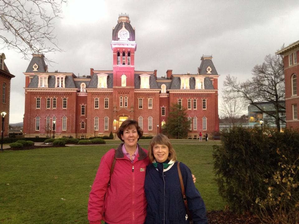 Maureen Dezell, left, and Liz Atwood in front of Woodburn Hall at West Virginia University.