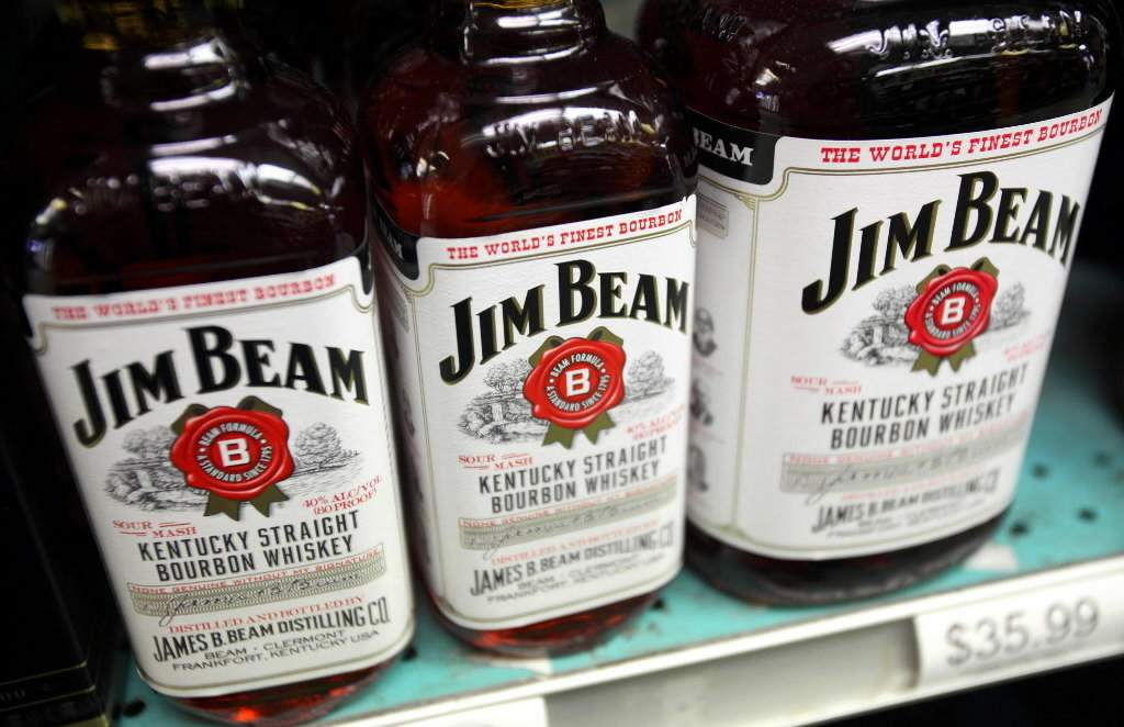 Bottles of Jim Beam bourbon sit on a shelf in a liquor store in Deerfield, Illinois,