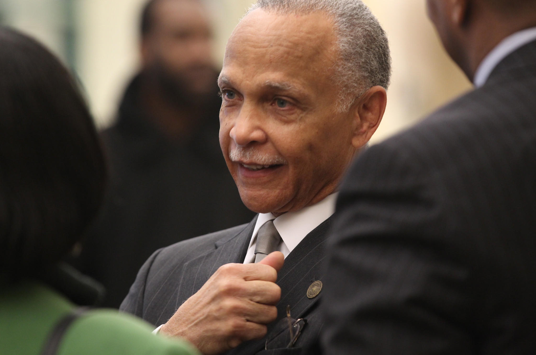 Chicago State University President Wayne Watson talks with attendees at a C.S.U. board meeting in 2013.
