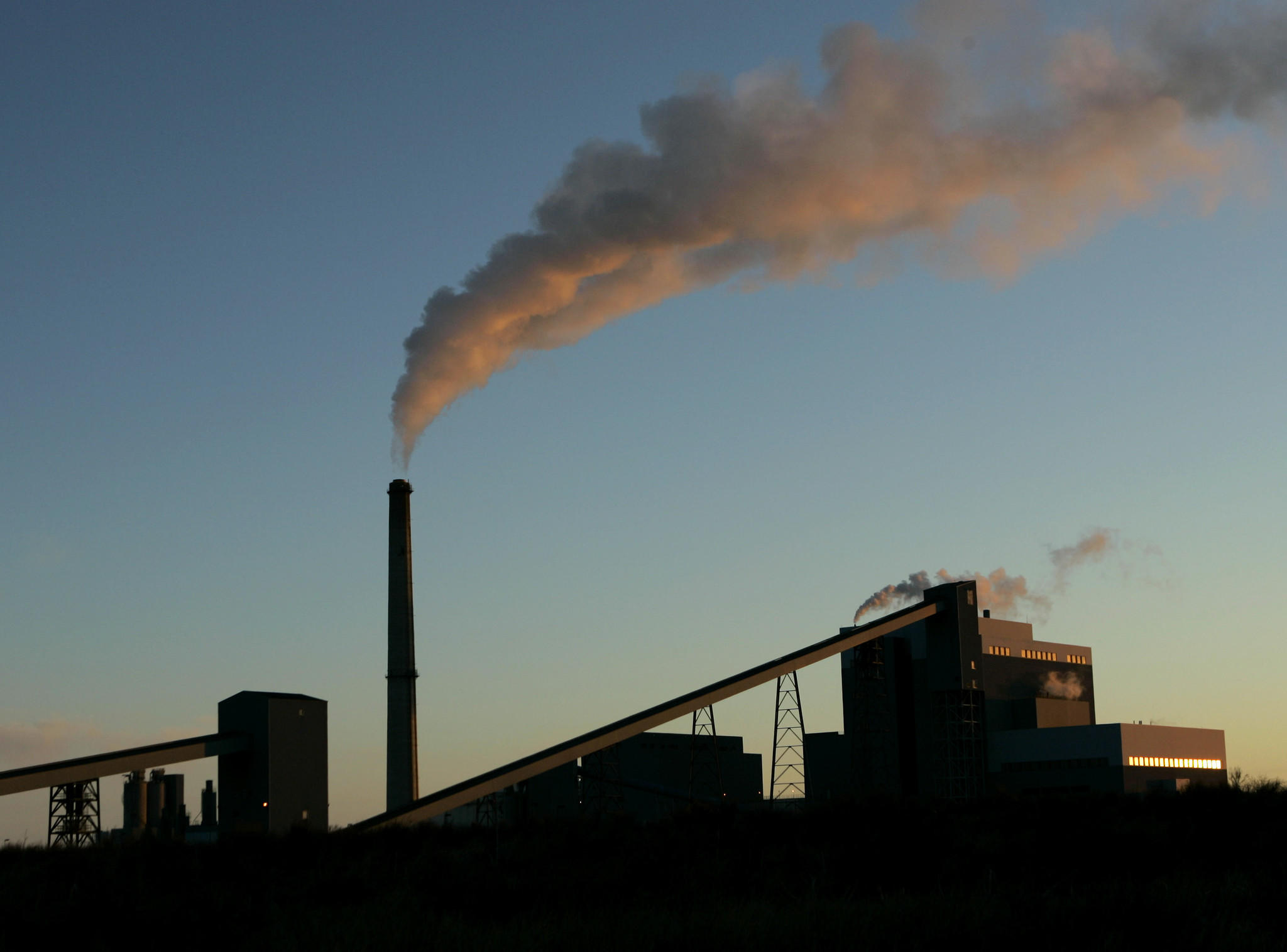 U.S. carbon emissions from the energy sector rose about 2% in 2013 after years of decline because of a small increase in the use of coal to generate electricity, the U.S. Energy Information Administration says. Above, a file photo of a coal-fired power plant in Holcomb, Kan.