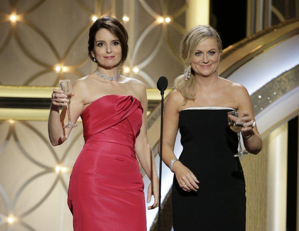 Tina Fey, left, and Amy Poehler hosted Sunday's Golden Globe Awards for the second straight year.