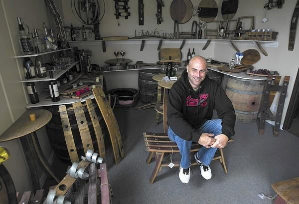 John Heilman, owner of The Winey Guys in Costa Mesa, builds furniture and other items out of wine barrels.