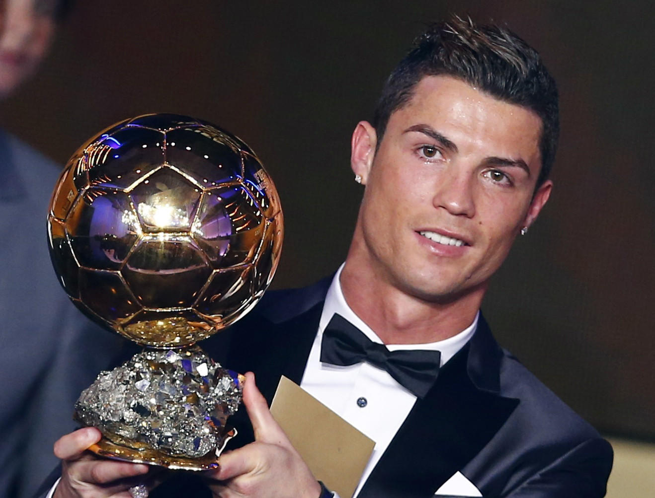 Portugal's Cristiano Ronaldo holds his trophy after being awarded the FIFA Ballon d'Or 2013 in Zurich January 13, 2014. Portugal and Real Madrid forward Cristiano Ronaldo was named the world's best footballer for the second time on Monday, preventing his great rival Lionel Messi from winning the award for a fifth year in a row.