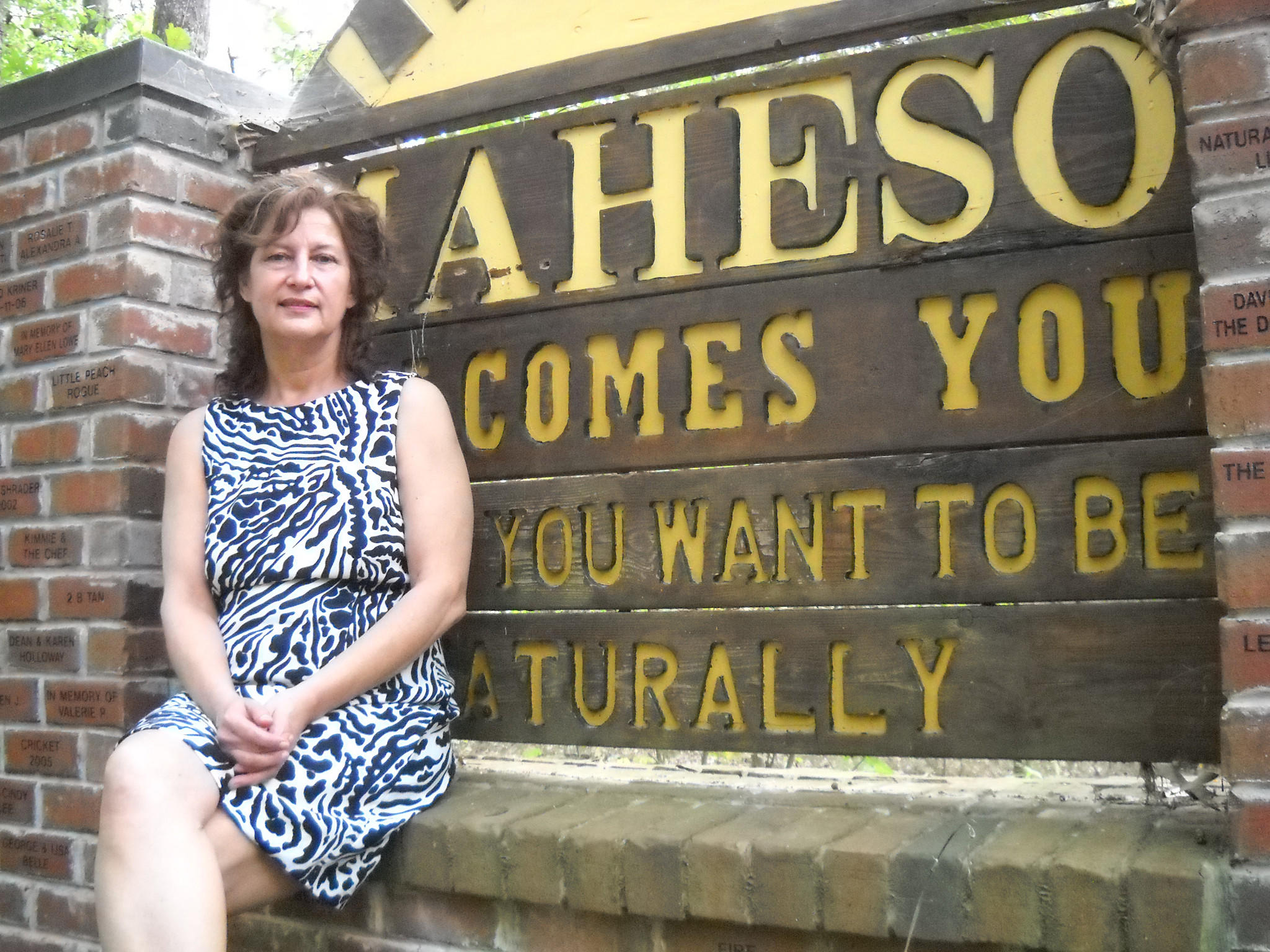 Catherine Holmes, 54, shown last summer at the entrance of the Maryland Health Society, a nudist camp in Davidsonville.