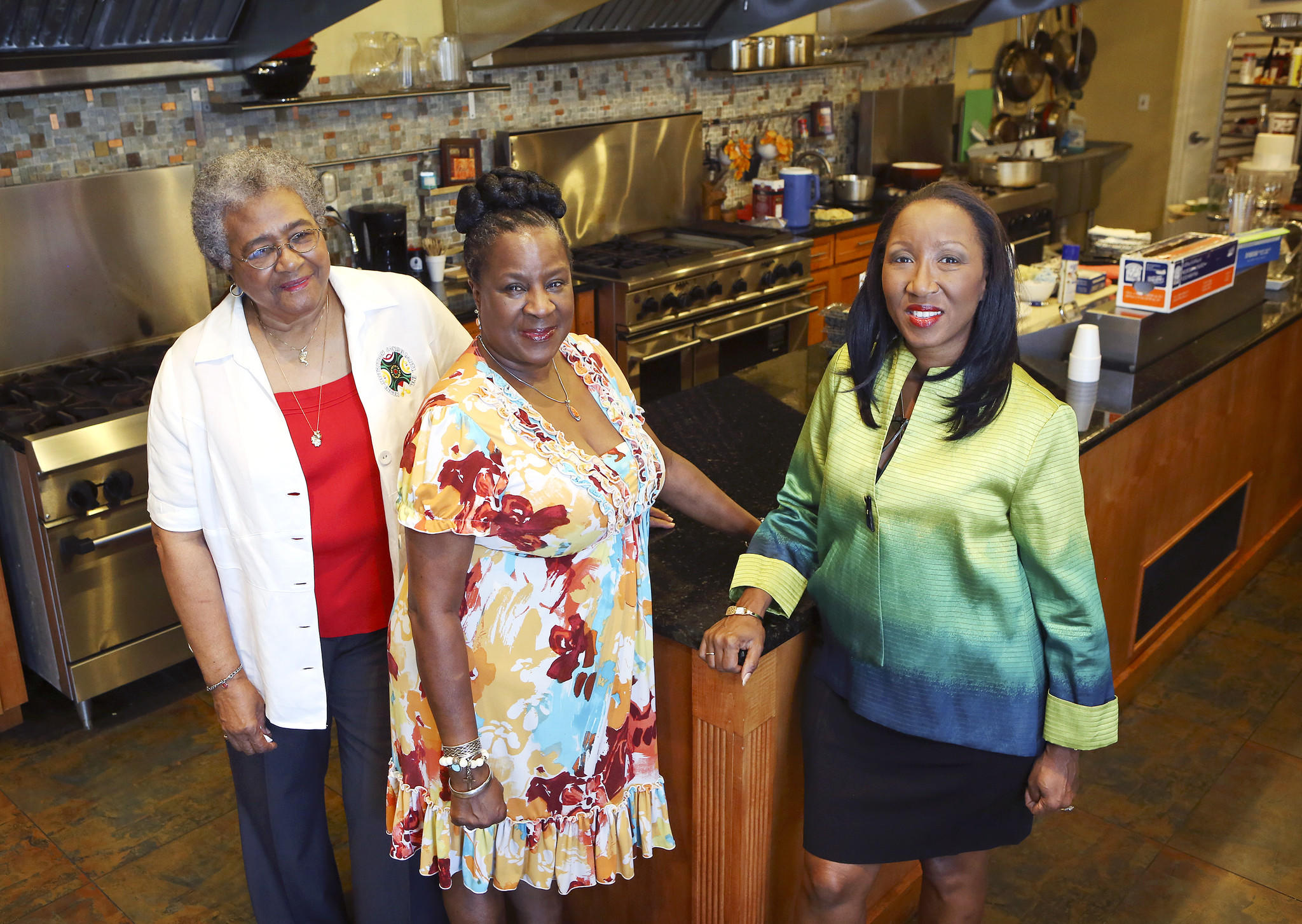 Ellareetha Carson, Fabiola Gaines and Roniece Weaver, left to right, inside of the kitchen at Hebni Nutrition Consultants, Inc. in Orlando on August 21, 2013.