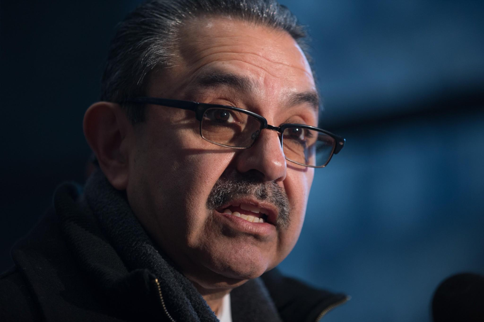 Ex-Chicago Ald. Ambrosio Medrano reads the comments he made to the judge during his sentencing to reporters at the Dirksen U.S. Courthouse in Chicago on Friday. Medrano was sentenced to 10 - 1/2 years in prison, but faced up to 17 in the first of his two fraud convictions.