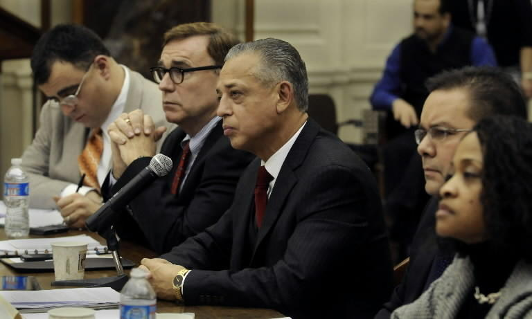 Matthew Poland, second from left, sat next to Mayor Pedro Segarra as school board appointees answered questions from city council members during a confirmation hearing.