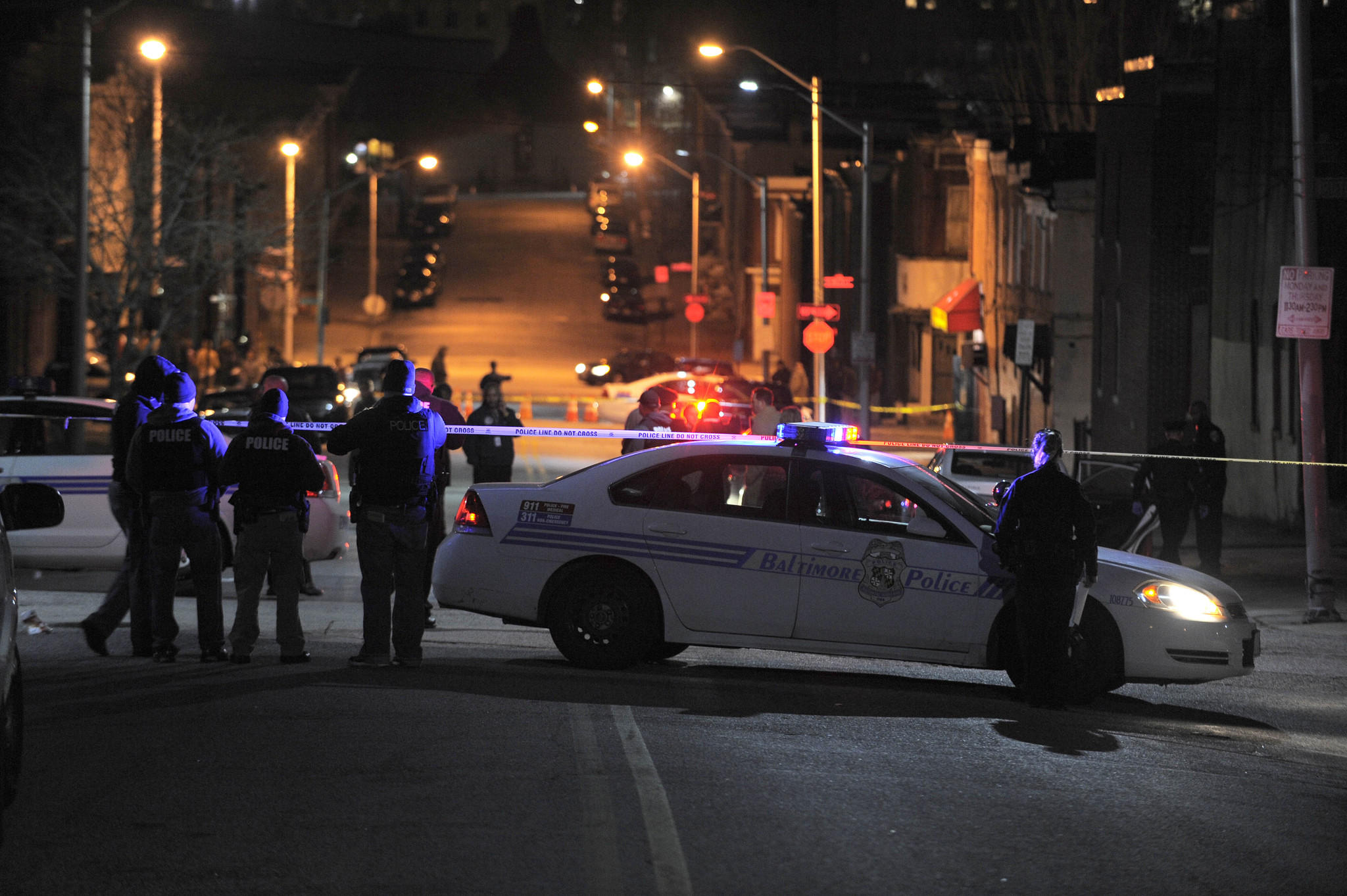 Baltimore police investigate the scene of an officer-involved shooting Monday in East Baltimore.