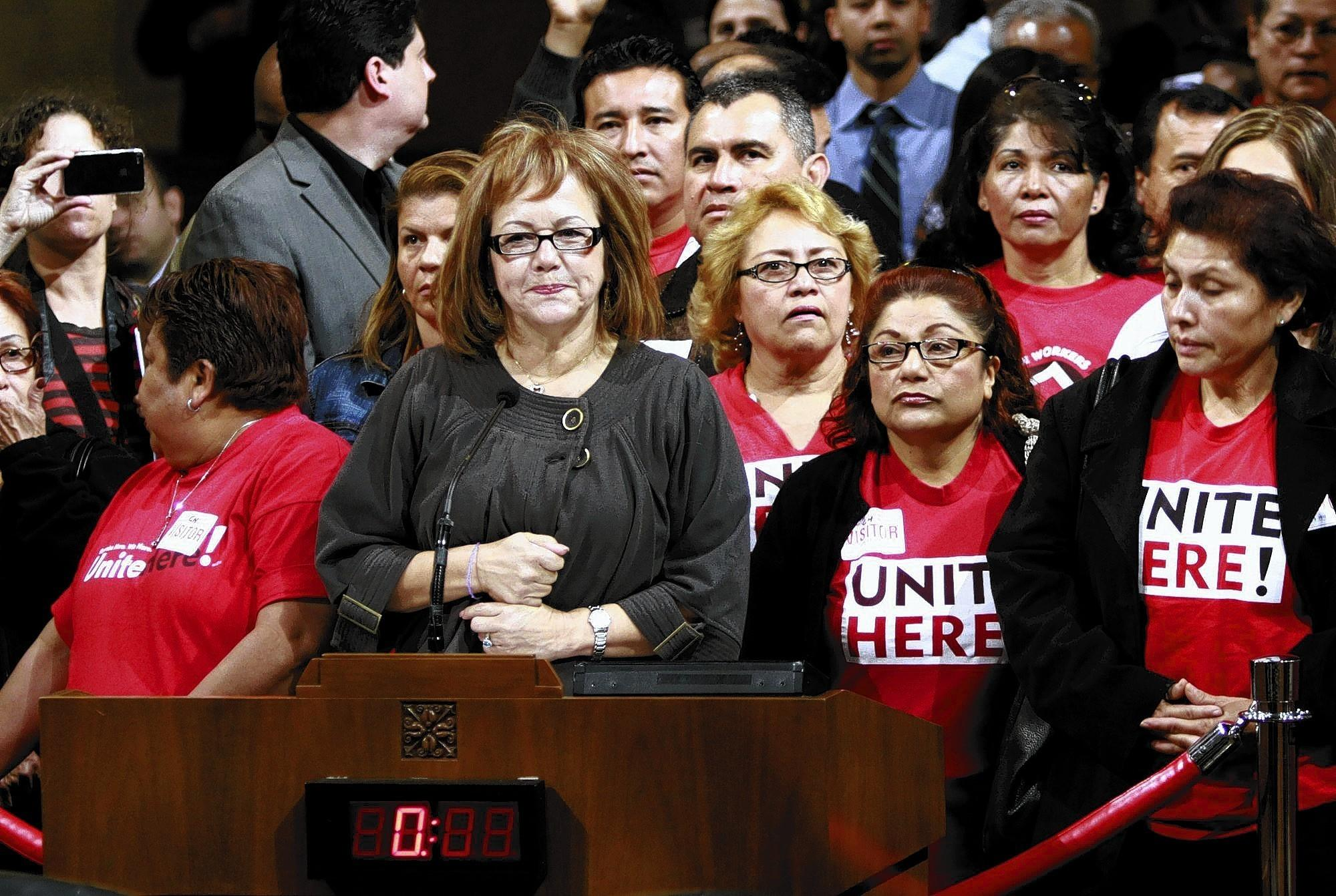 Maria Elena Durazo, center, of the county Federation of Labor, says labor leaders hope a coming Los Angeles proposal to require large hotels to pay workers at least $15 an hour will spread to other industries.