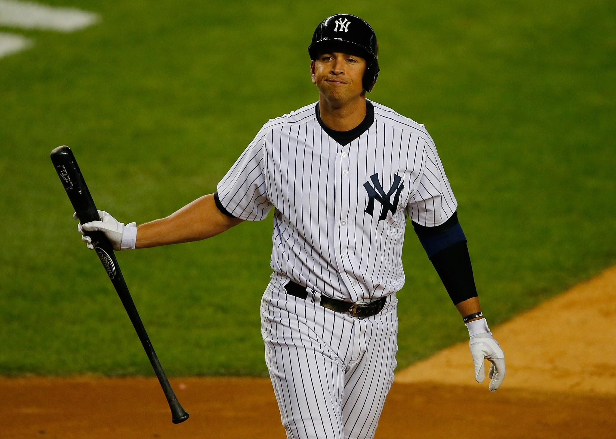 Alex Rodriguez #13 of the New York Yankees reacts after striking out in the fifth inning against the Tampa Bay Rays at Yankee Stadium on September 25, 2013.