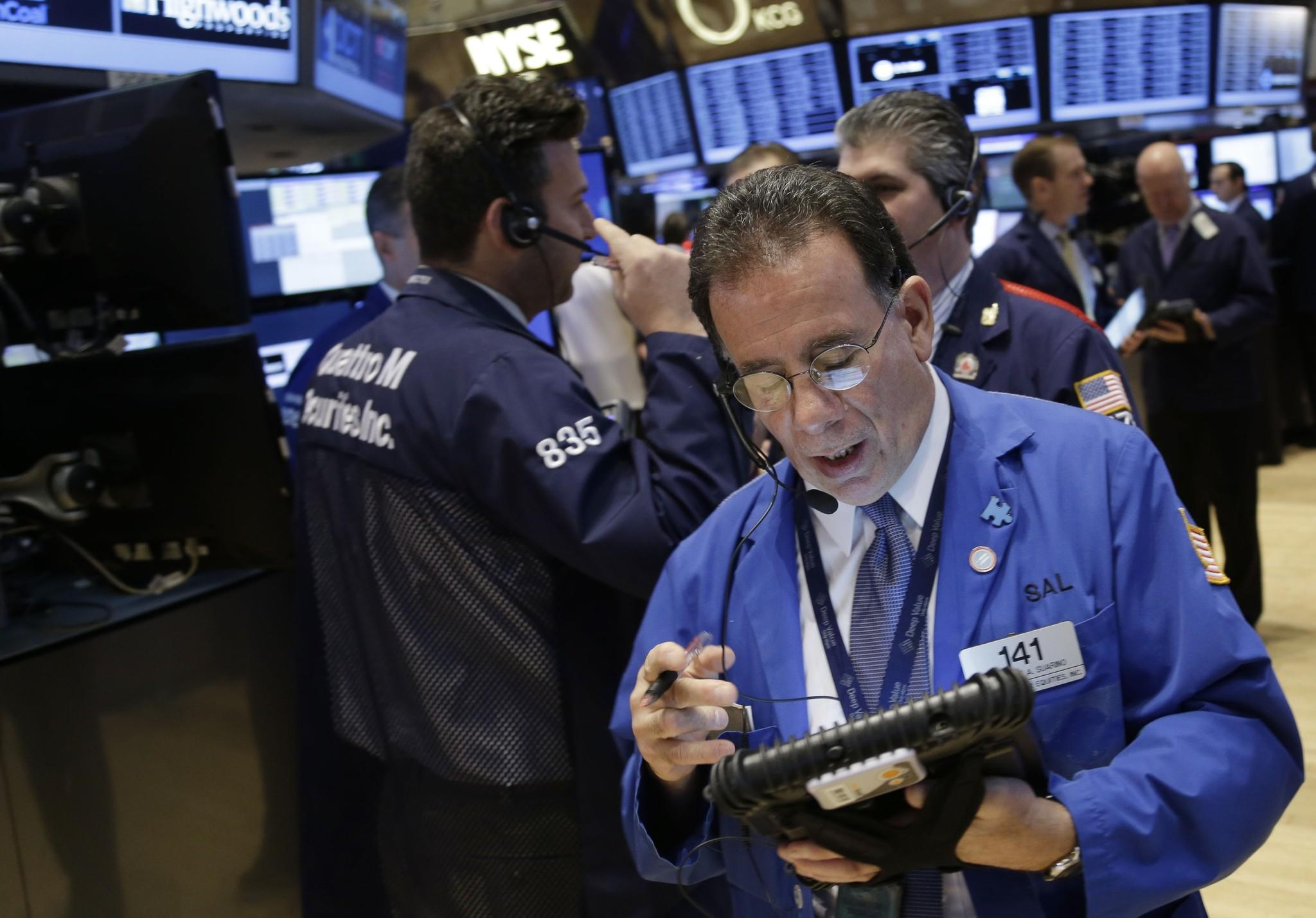 The California Public Employees' Retirement System, the country's biggest public pension fund, was helped in 2013 by the stock market's best year since 1997. Above, traders on the floor of the New York Stock Exchange on Dec. 31.