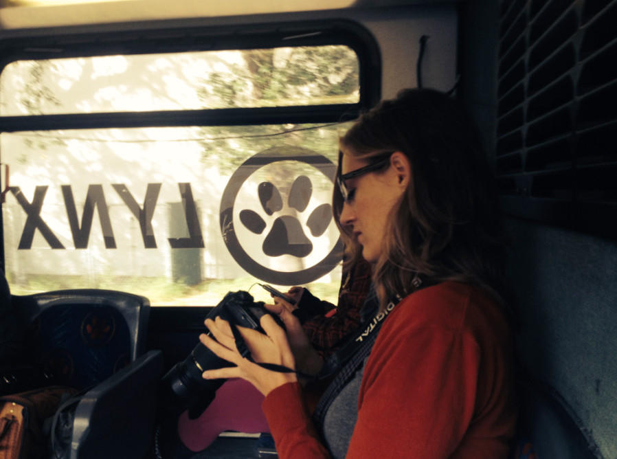 Delila Smalley photographs the scenery aboard LYNX route 25 as part of the Transit Interpretation Project.