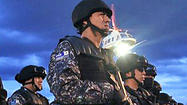 Mexico troops clash with vigilante groups; 12 reported killed