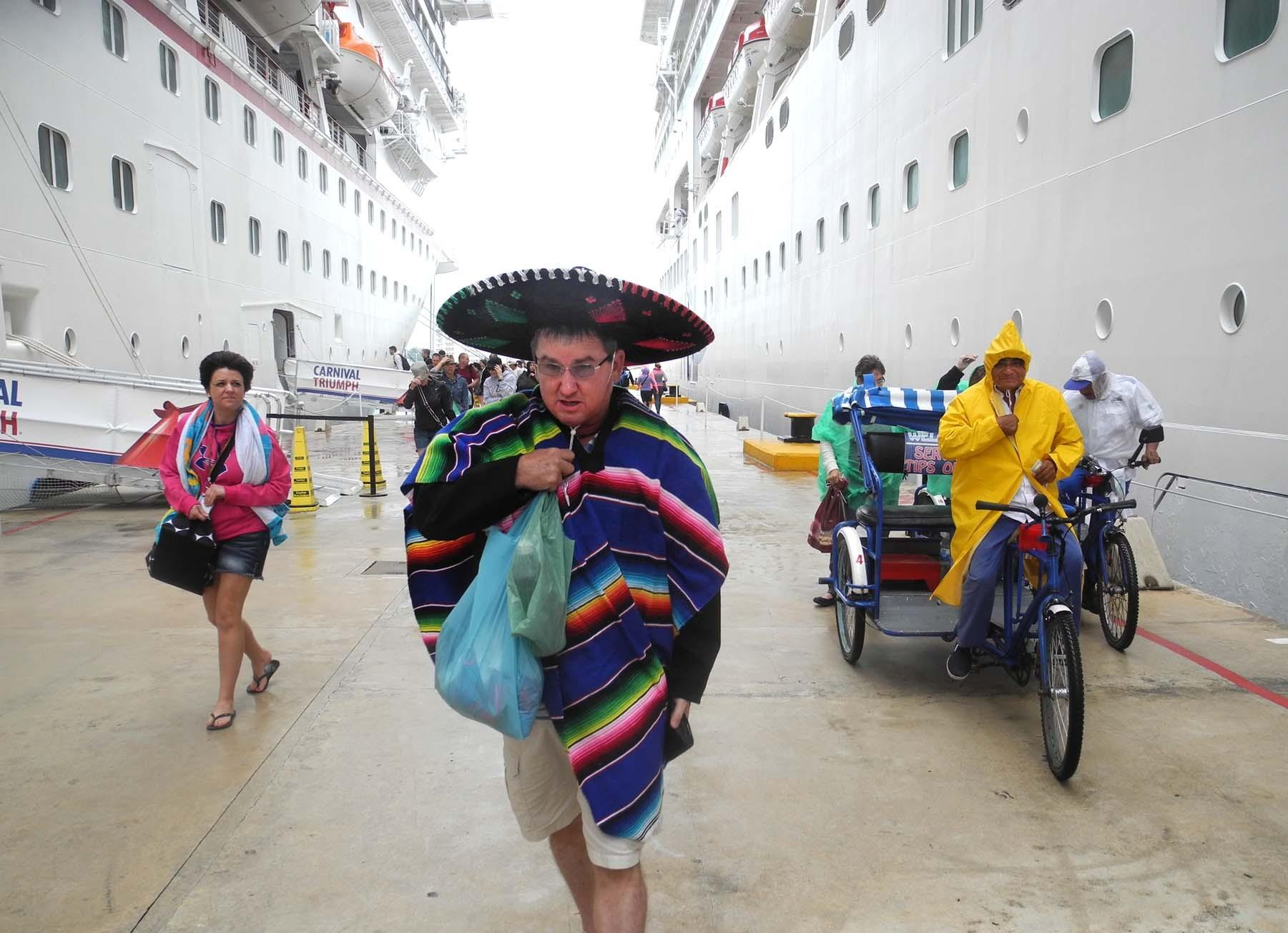 A tourist returns to his cruise ship in Cozumel, Mexico, after buying souvenirs on Jan. 13, 2014.