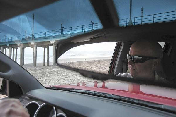 Chris Clarke, a marine safety officer with the Huntington Beach lifeguards, patrols the beach.