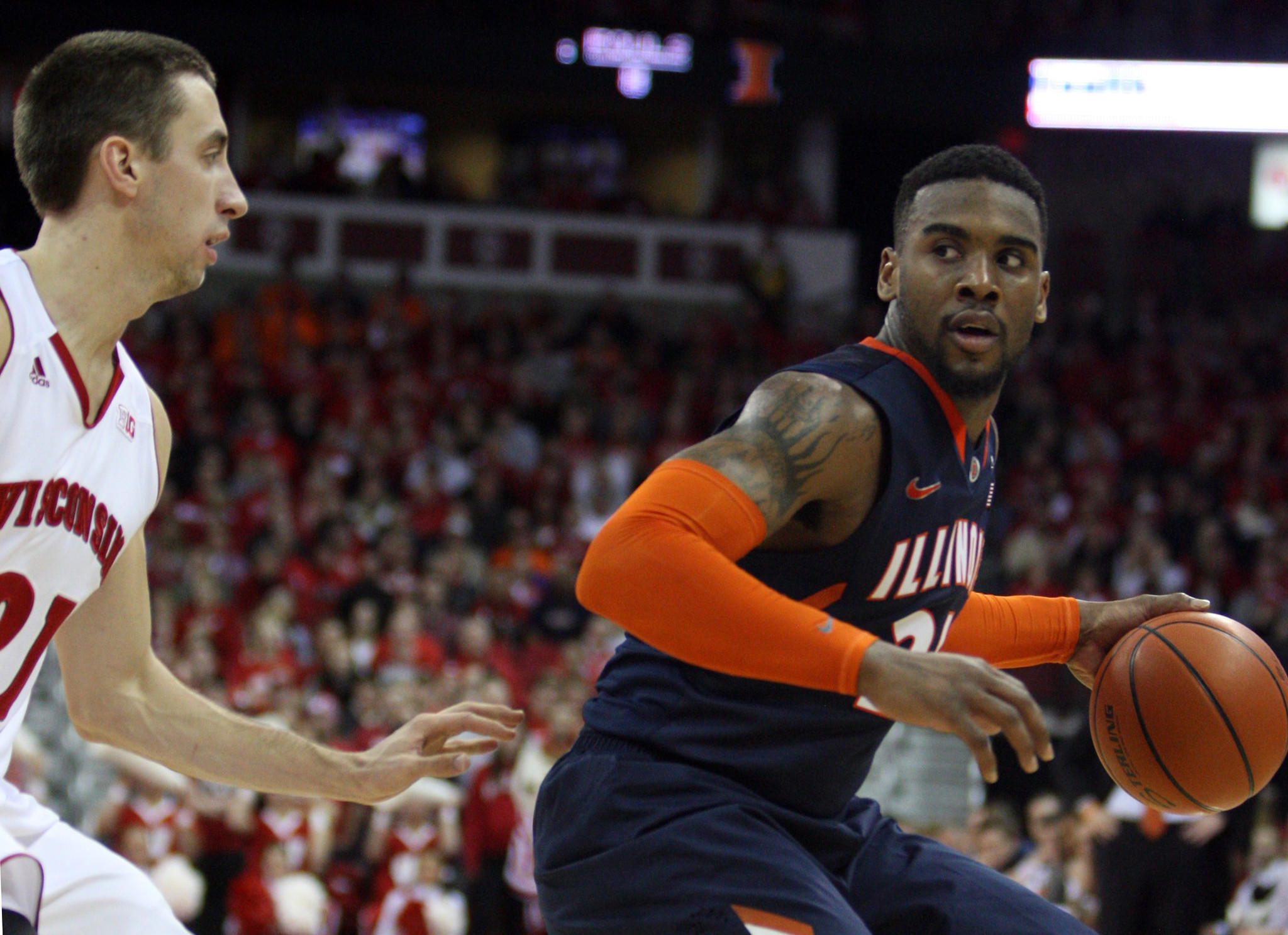 Illinois Fighting Illini guard Rayvonte Rice (right) looks to pass as Wisconsin Badges guard Josh Gasser (left) defends.