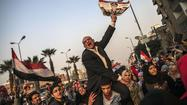 Clashes mar vote on Egypt's proposed constitution; 11 killed