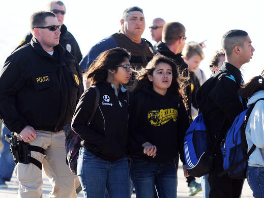 Students surrounded by police are escorted from Berrendo Middle School after a shooting, Tuesday in Roswell, N.M. Roswell police said the suspected shooter was arrested at the school.