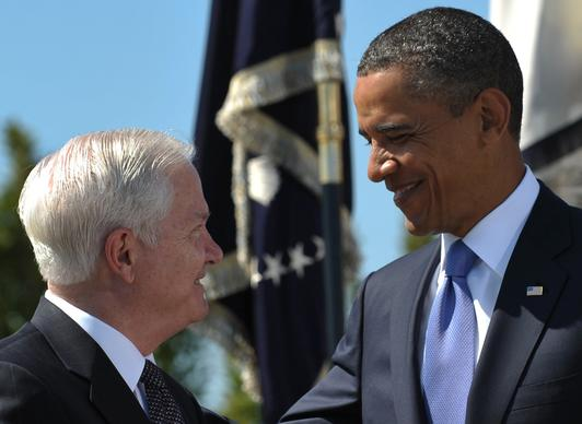 President Obama smiles at outgoing U.S. Defense Secretary Robert Gates after presenting him the Medal of Freedom during the Armed Forces Farewell Tribute in honor of Gates at the Pentagon in Washington, D.C., in 2011.