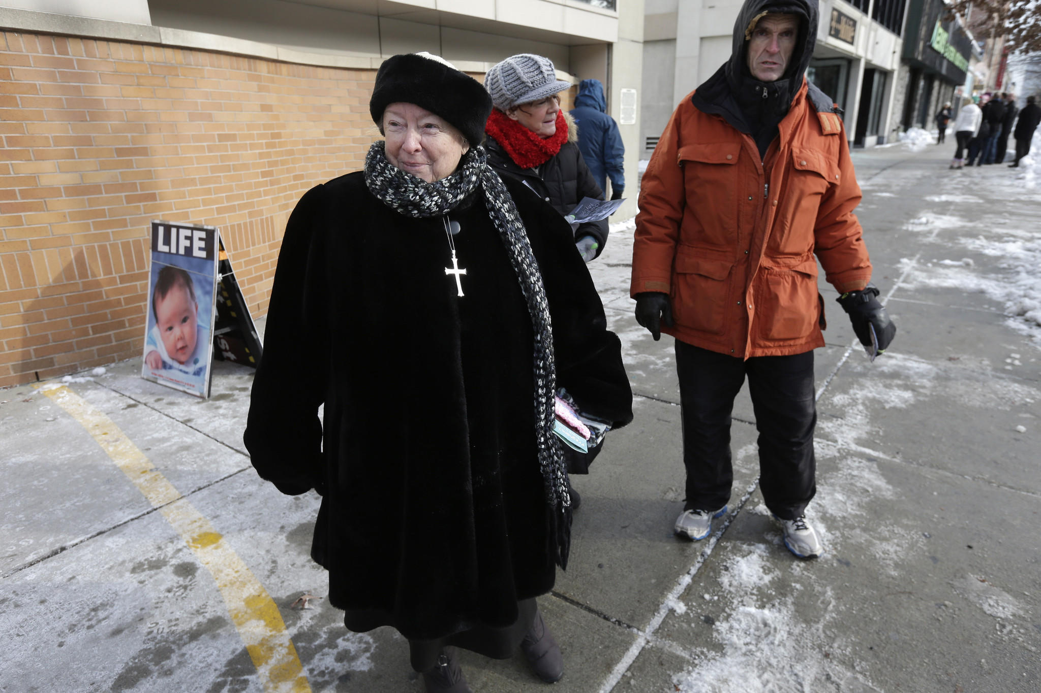 Eleanor McCullen of Boston, left, stands at the painted edge of a buffer zone outside a Planned Parenthood location in Boston.