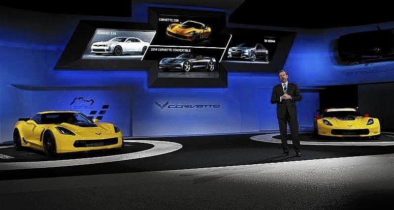 Daniel Ammann, President of GM, speaks between the Chevrolet Corvette Stingray ZO6 street version, left, and the racing version during the press preview day of the North American International Auto Show in Detroit, Michigan January 13