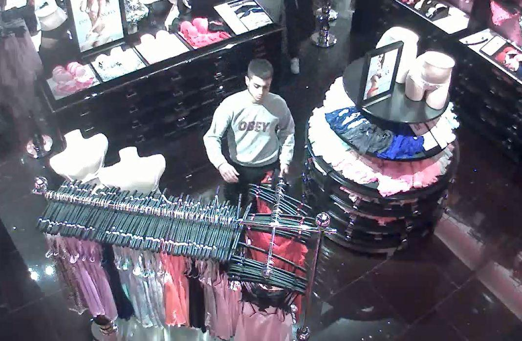 One of two suspects seen stealing items from Victoria Secret