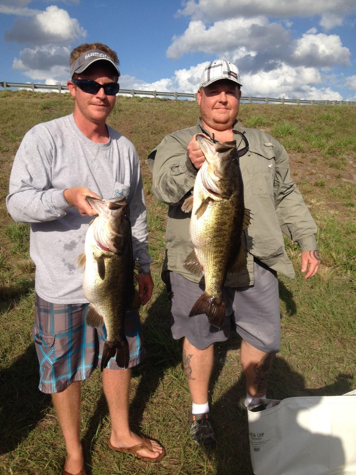 Kevin Love, left, with 7-pound, 6-ounce bass and his brother Eric with a club-record 10-1 that they caught on Lake Kissimmee to win a Renegades Bass Club tournament.