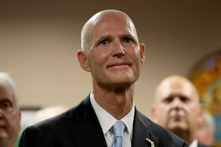 Florida Governor Rick Scott as he introduces Carlos Lopez-Cantera as his new lieutenant governor on January 14, 2014 in Miami, Florida.