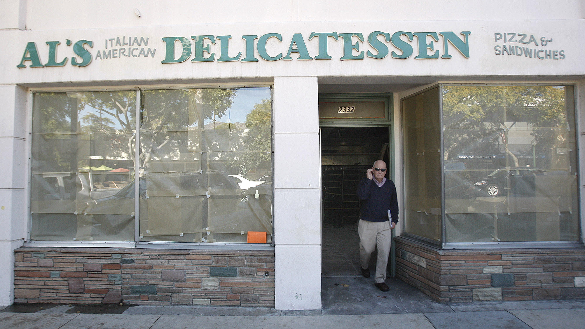 Crescenta Valley Chamber of Commerce President Steve Pierce walks out of the closed Al's Italian American Delicatessen in Montrose on Monday, Jan. 13, 2014. Pierce was checking out the progress of the construction for the restaurant that will re-occupy the vacancy.