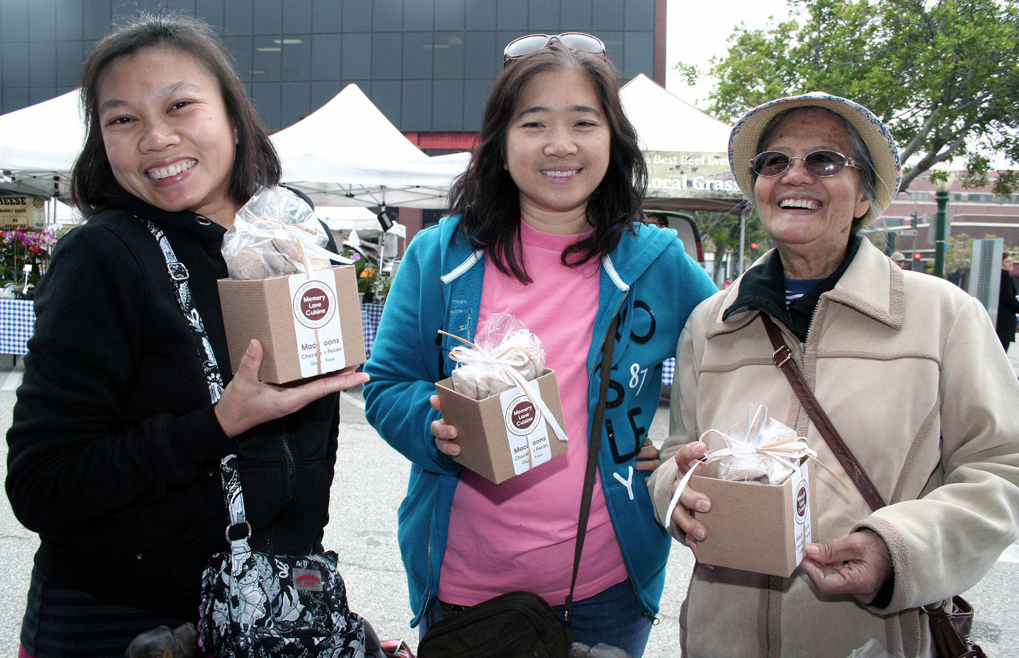 Happy with their macaroons are Downtown Glendale Market's first day customers: at left, Glendale neighbors Maricel Garcia, Be Salazar and Lucina Narciso.