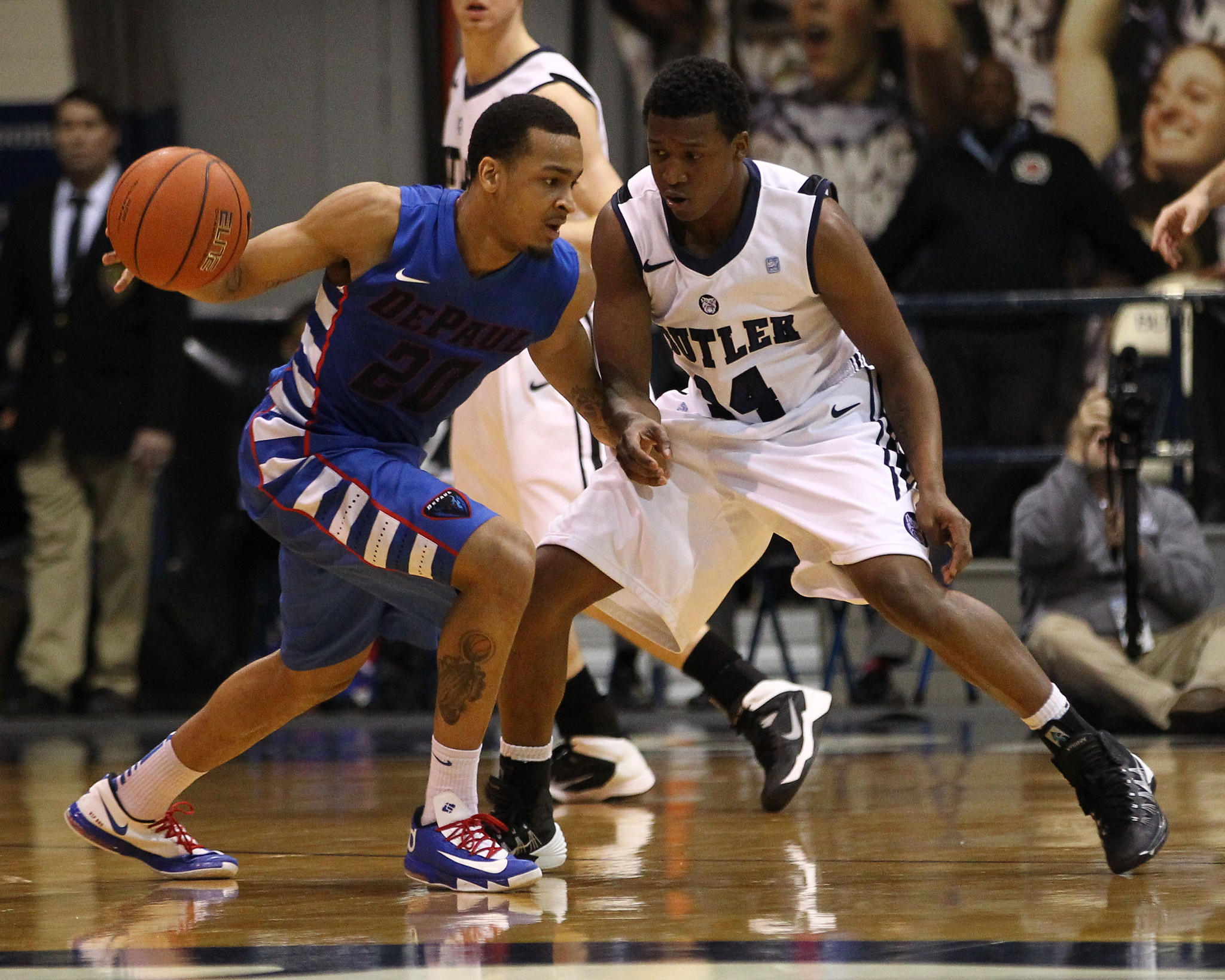 DePaul Blue Demons guard Brandon Young (20) dribbles the ball with Butler Bulldogs guard Rene Castro (14) defending during the second half at Hinkle Fieldhouse. DePaul won 99-94 in double overtime.