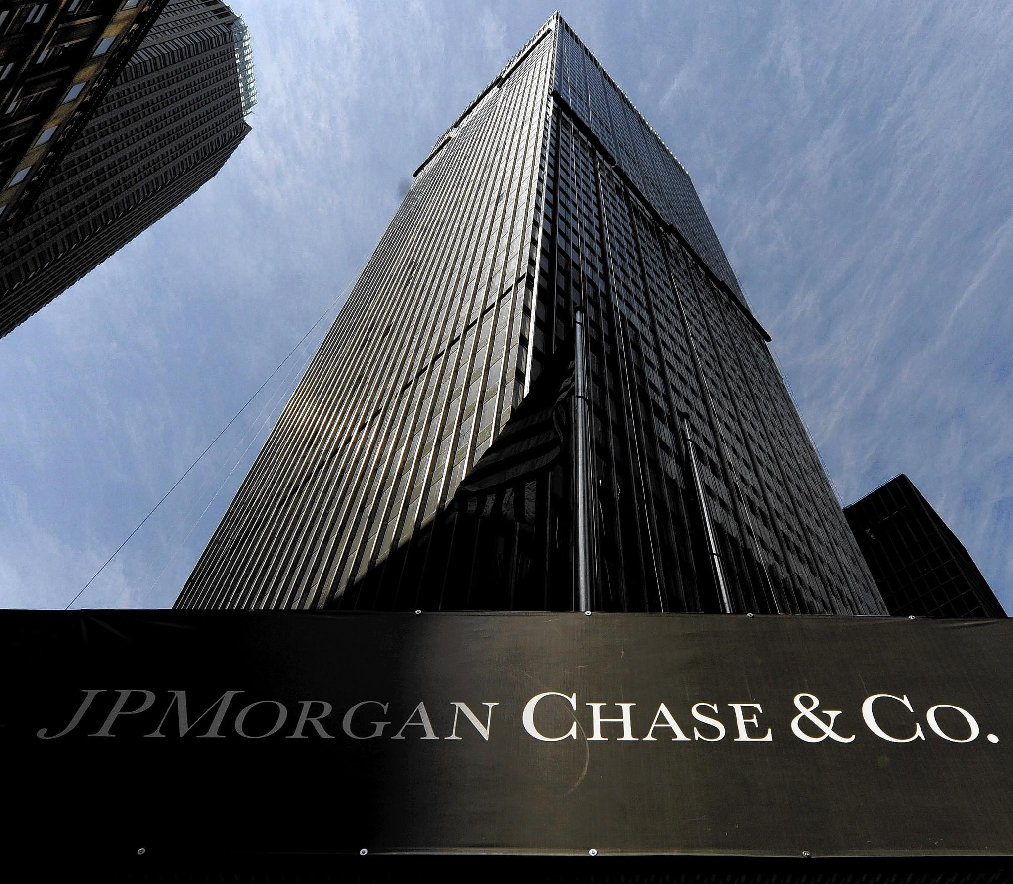 JPMorgan Chase, the nation's largest bank by assets, said it earned $5.3 billion in the fourth quarter, down 7% from $5.7 billion a year earlier. Above, its building in New York.
