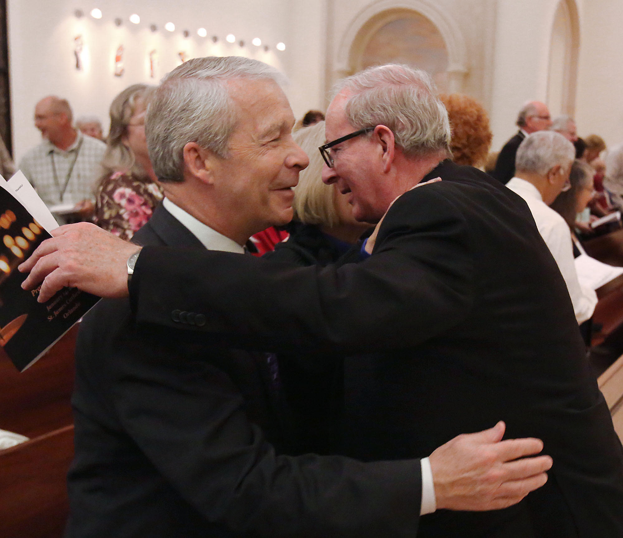 Dr. Joel Hunter, pastor of Northland Church, left, is hugged by Bishop John Noonan during an Interfaith Prayer Service for Peace at St. James Cathedral in Orlando on Tuesday, January 14, 2014.
