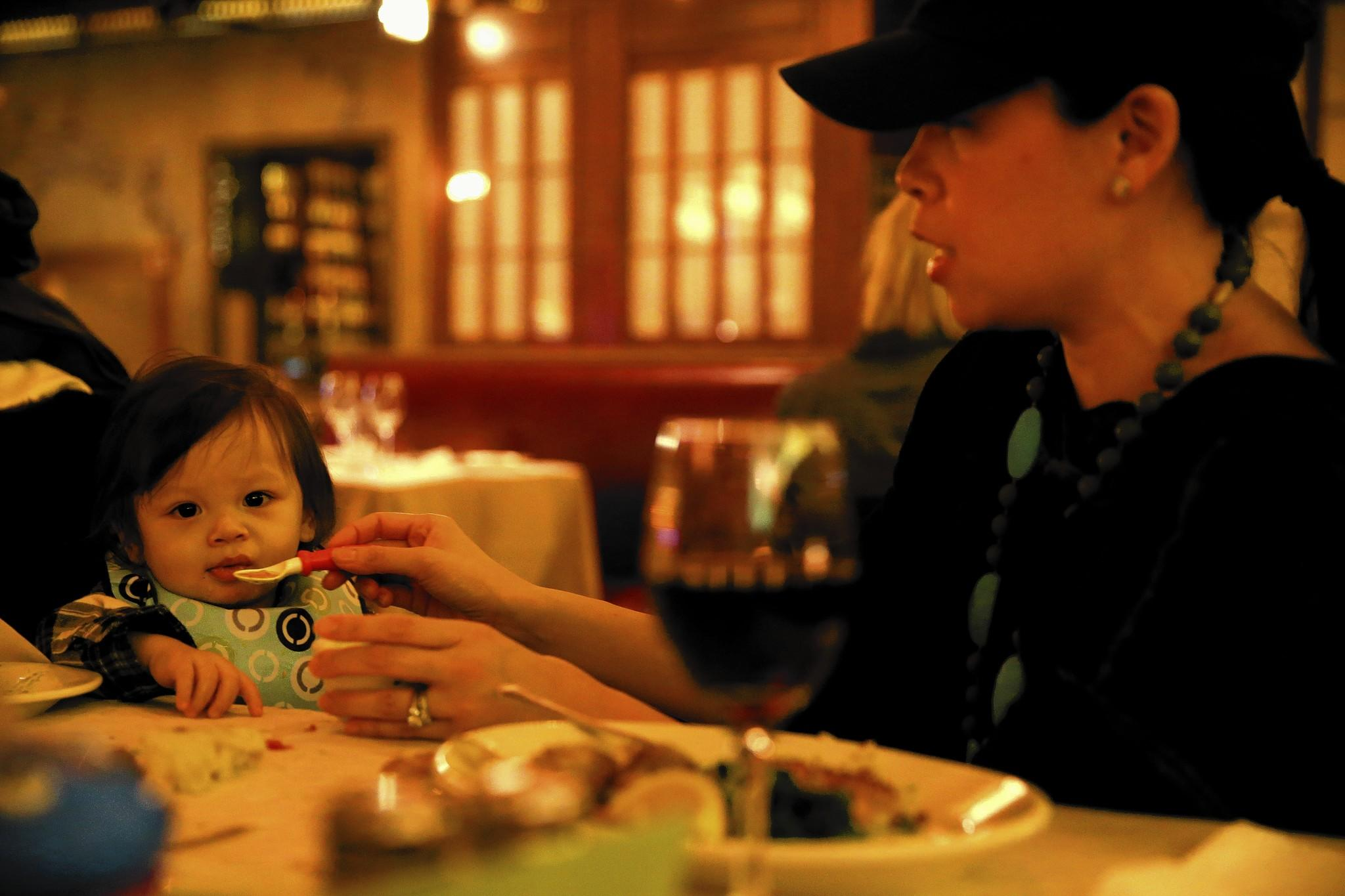 Kim Hartmann and her son, Liam, 14 months, dine at Scoozi in Chicago.
