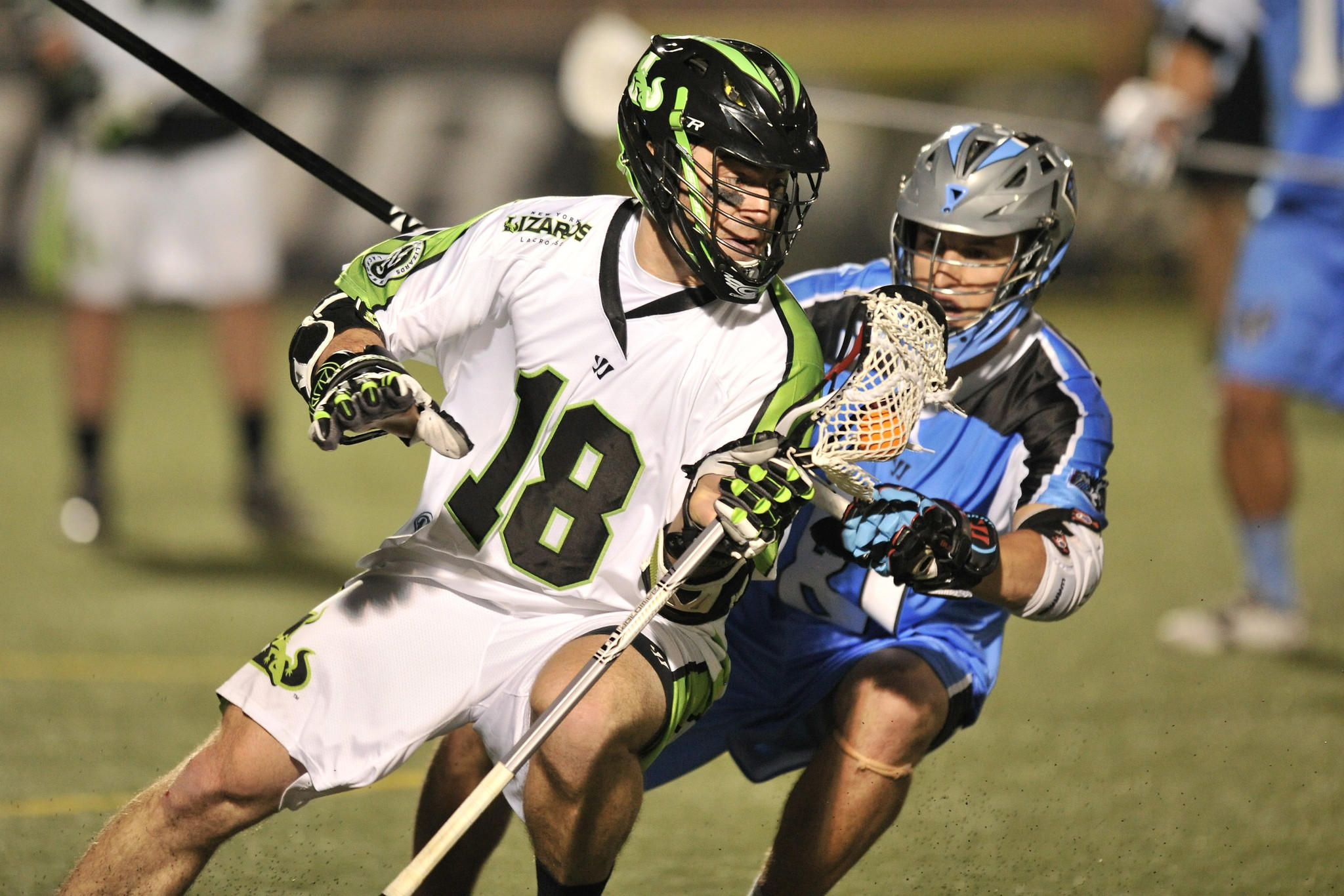 DELAWARE, OH - MAY 18: Stephen Peyser #18 of the New York Lizards controls the ball in the fourth period as Kyle Hartzell #81 of the Ohio Machine defends on May 18, 2013 at Selby Stadium in Delaware, Ohio. New York defeated Ohio 14-8. (Photo by Jamie Sabau/Getty Images) ORG XMIT: 166352311
