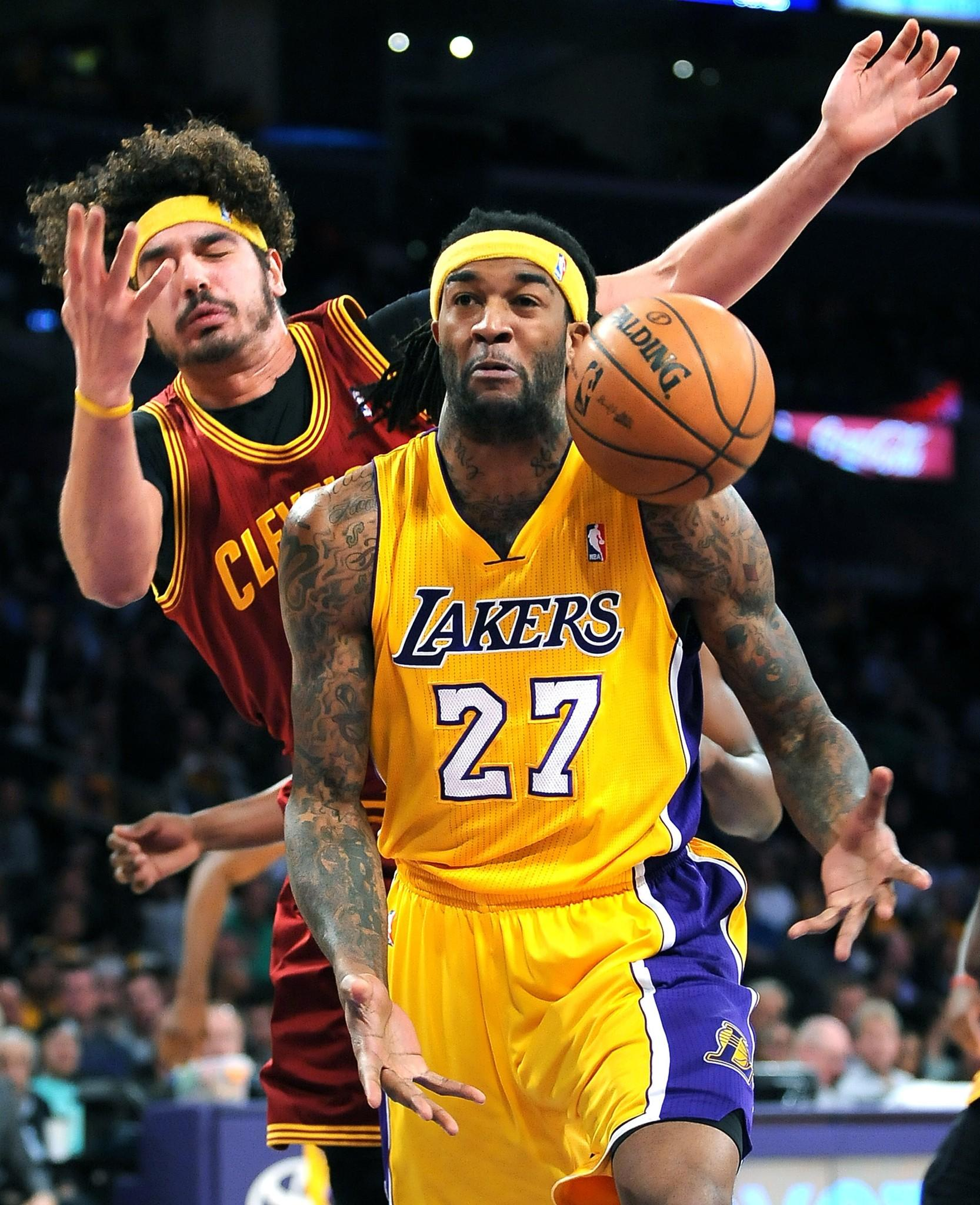 Jordan Hill and Cleveland's Anderson Varejao battle for a rebound during the first half Tuesday at Staples Center.