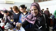 Egyptian authorities claim high turnout in vote on constitution