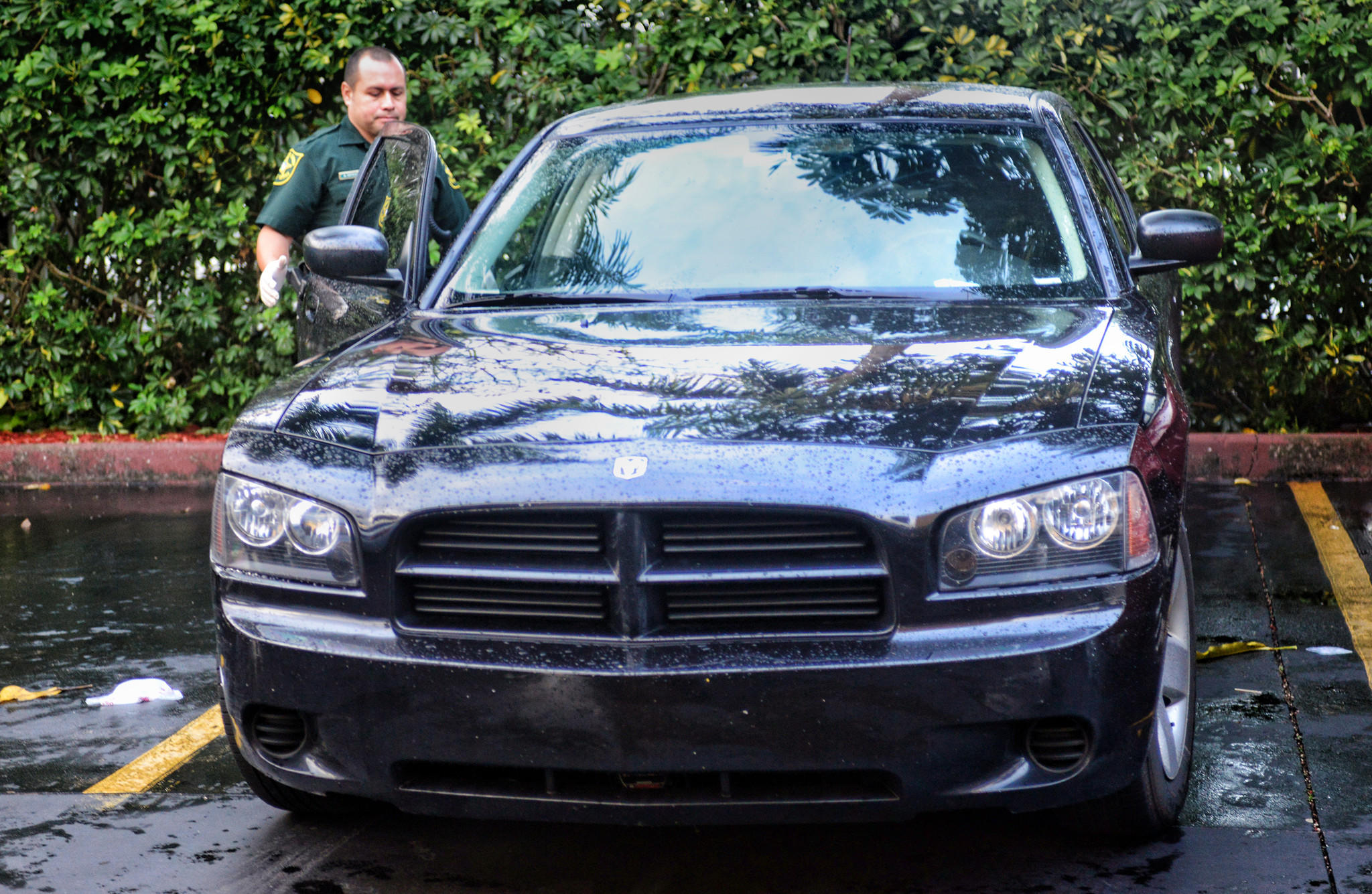 A BSO Deputy examines a recovered undercover Ft. Lauderdale Police Dept. car which was stolen, Wednesday, Jan 15, 2014, at the Days Inn on Oakland Park Blvd., just west of I-95.