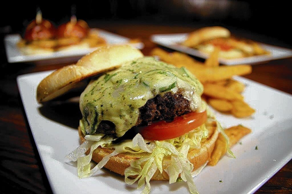 Elixir Bar Room & Hash House jalapeno burger with an avocado ranch drizzle.