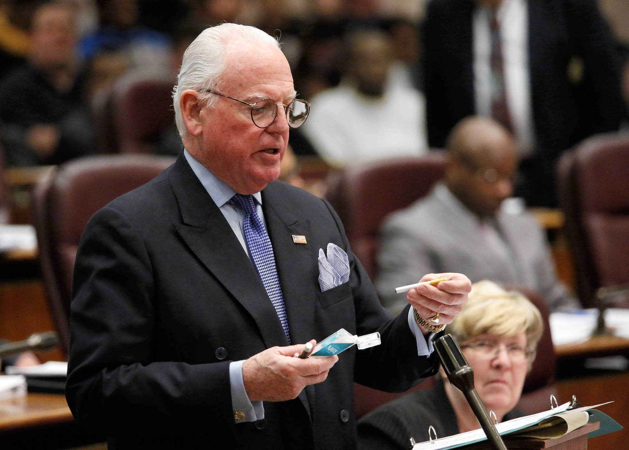 Ald. Edward Burke, 14th, holds an NJOY electronic cigarette during a discussion regarding an ordinance brought to the City Council banning the electronic cigarette in most indoor public places seen here at the council meeting at Chicago's City Hall. The ordinance passed with a 45-4 vote.