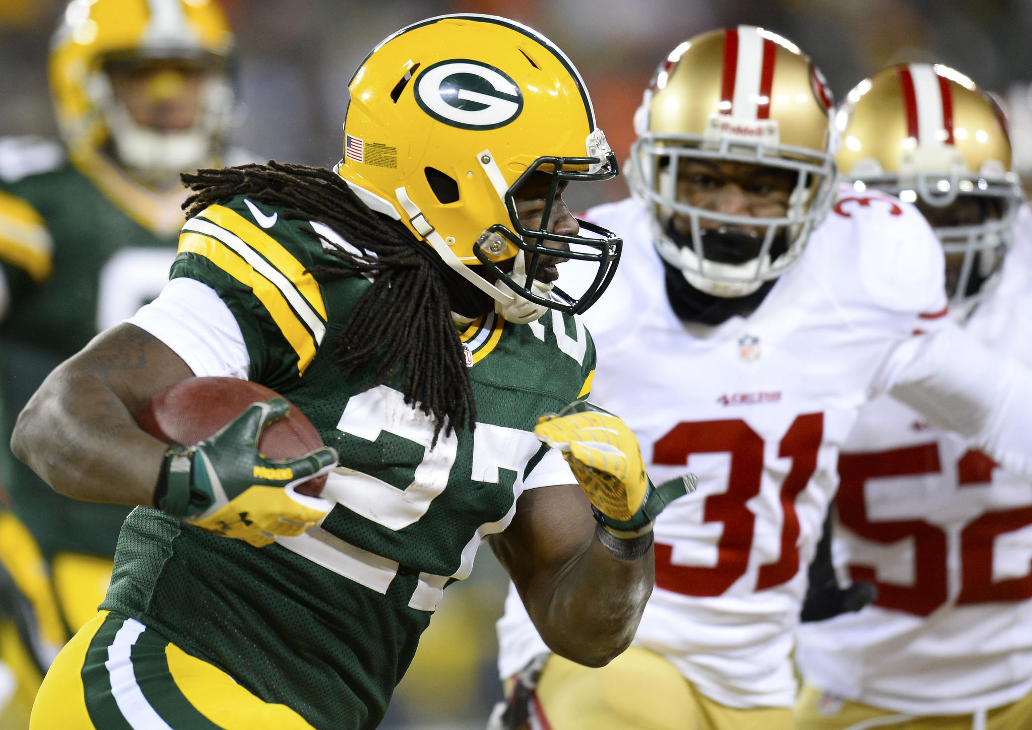 Green Bay Packers running back Eddie Lacy (27) carries the ball in front of San Francisco 49ers strong safety Donte Whitner (31) during the second quarter of the 2013 NFC wild card playoff football game at Lambeau Field.