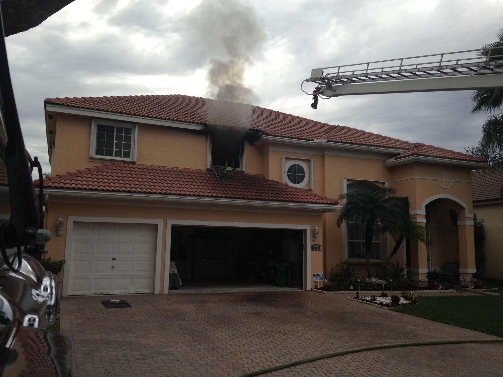 A man and an elderly woman escaped the flames in a Coral Springs house fire