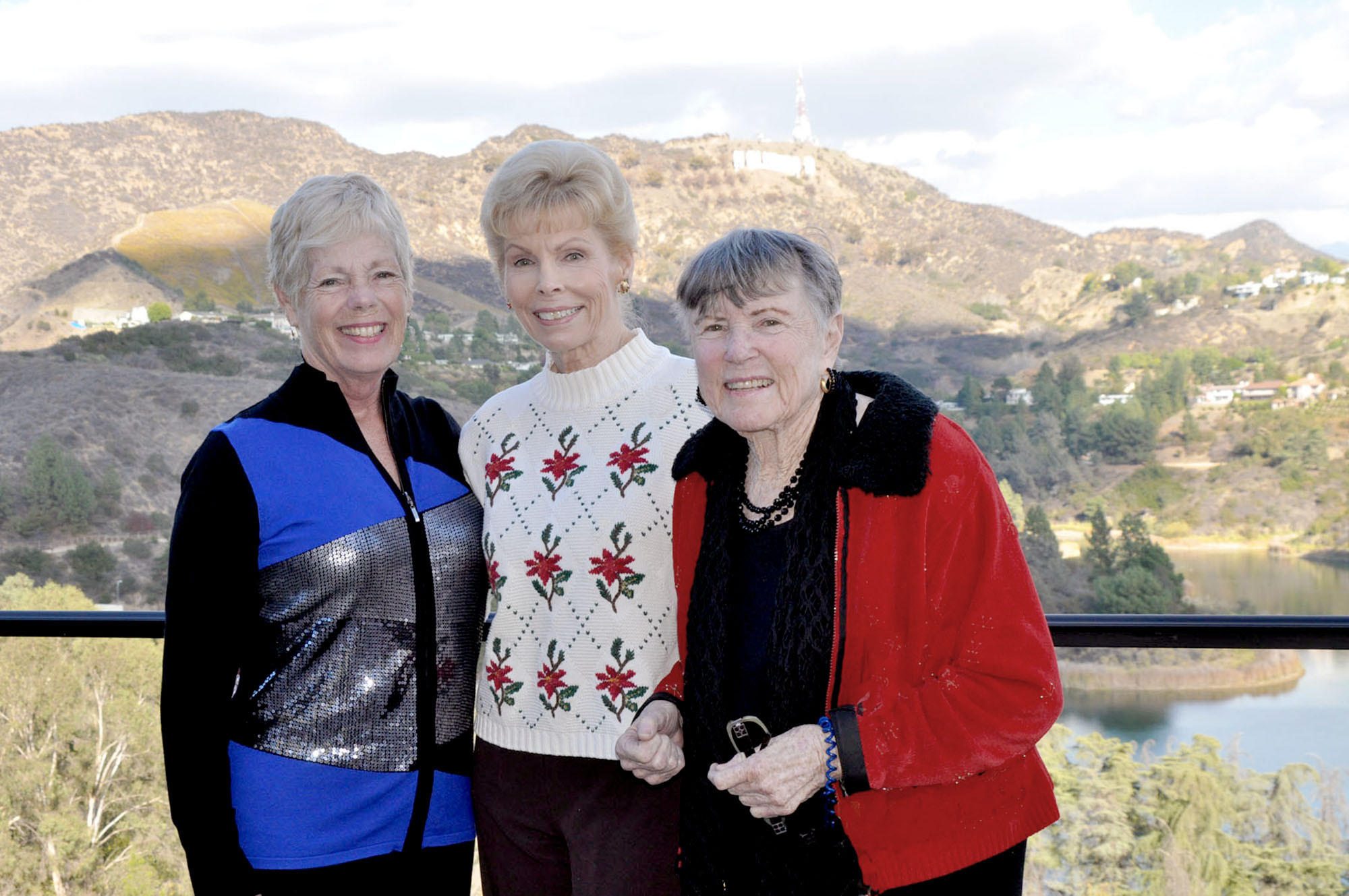 Chris Halajian, president of Oakmont League of Glendale, left, chats with League members Jeri Benton and Mary Lane. Lane hosted a recent League luncheon at her Hollywood Hills home overlooking Lake Hollywood and the famed Hollywood sign.