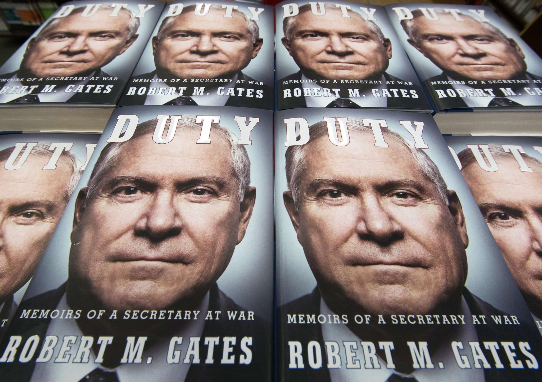 "Stacks of former U.S. Defense Secretary Robert Gates' book ""Duty, Memoirs Of A Secretary At War"" are seen in Fairfax, Va."