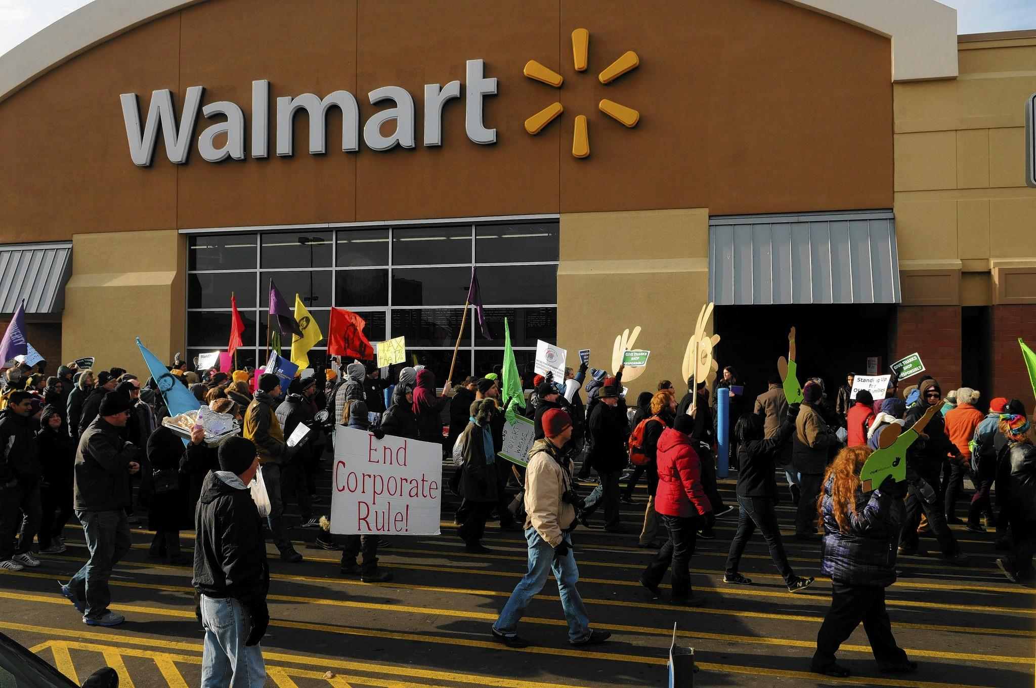 Wednesday's NLRB filing stems from the agency's findings released in November that deemed unlawful Wal-Mart's reactions to employees who participated in strikes around Black Friday in 2012. Above, protestors at a Wal-Mart in St. Paul, Minn., on Nov. 29, 2013.