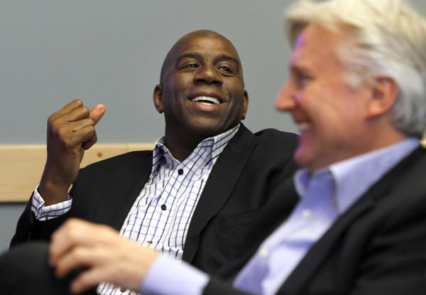 Magic Johnson, with fellow Dodgers owner Mark Walter, is among the people that think Lakers owner and executive Jim Buss could use help running the team.