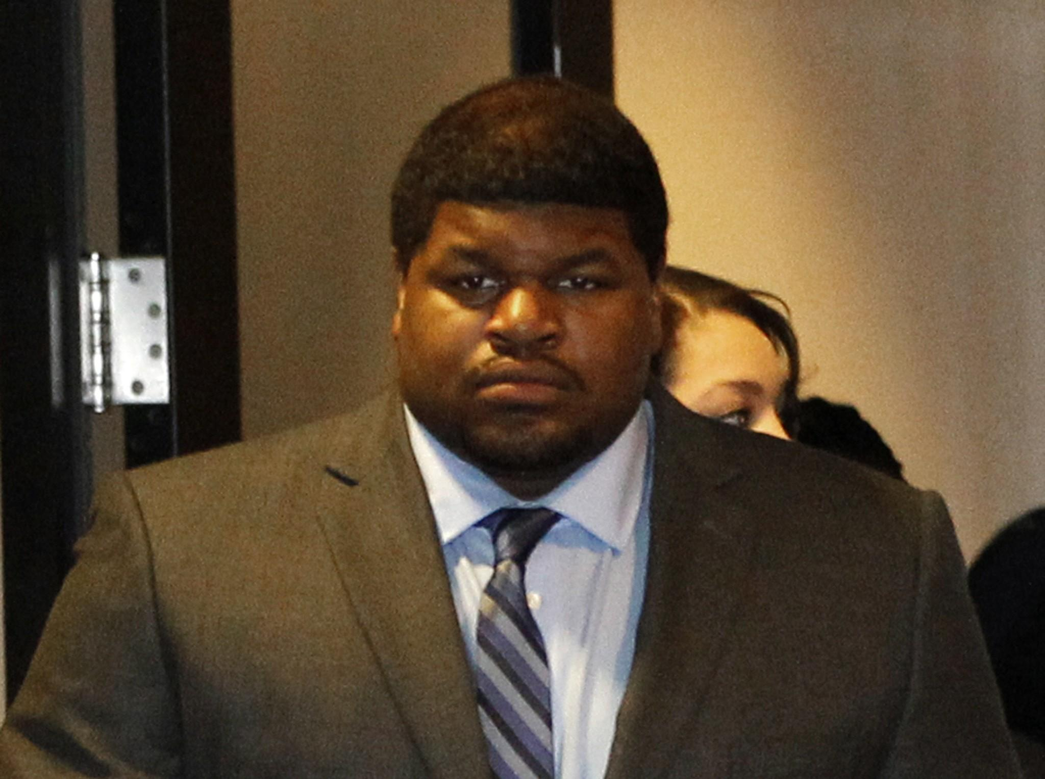 Former Cowboys player Josh Brent enters the courtroom in Dallas. Brent is facing intoxication manslaughter chargers after he crashed his car, killing his friend and teammate Jerry Brown in 2012.