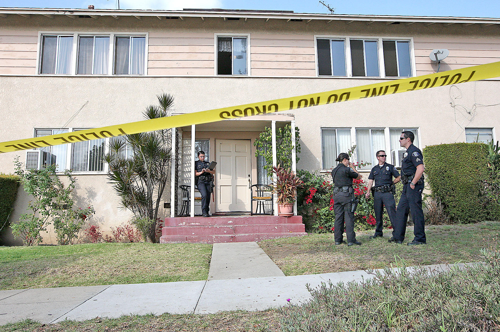 Glendale police investigate the scene of a homicide at 1830 Irving Ave. on Monday, November 18, 2013.