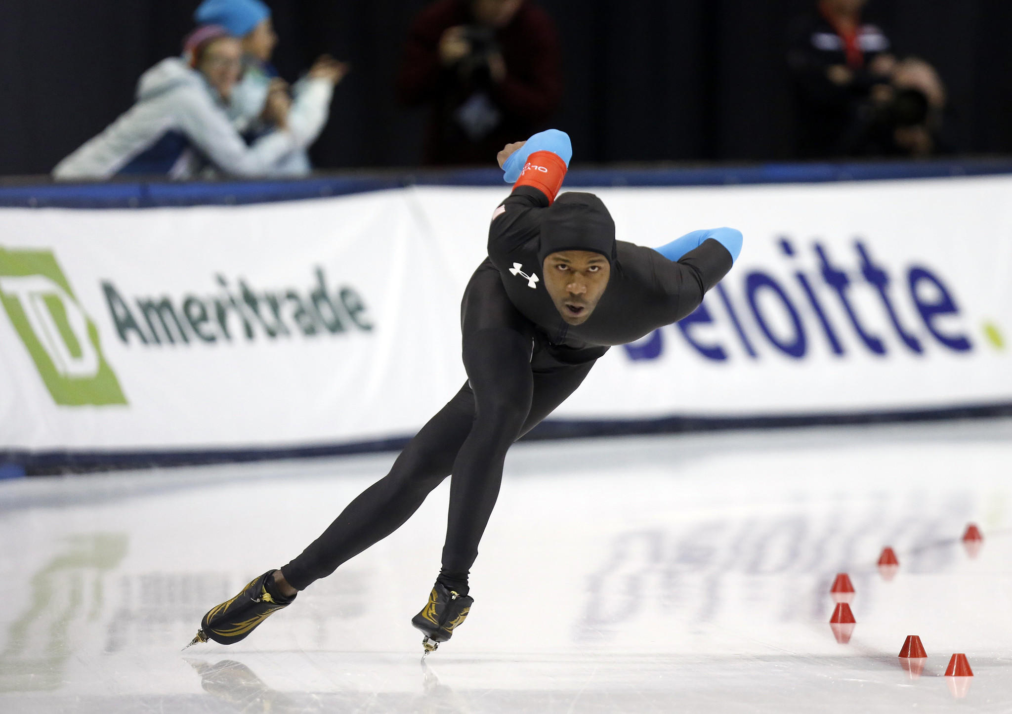 First place finisher Shani Davis competes in the men's 1500m during the U.S. Olympic speedskating trials at Utah Olympic Oval.