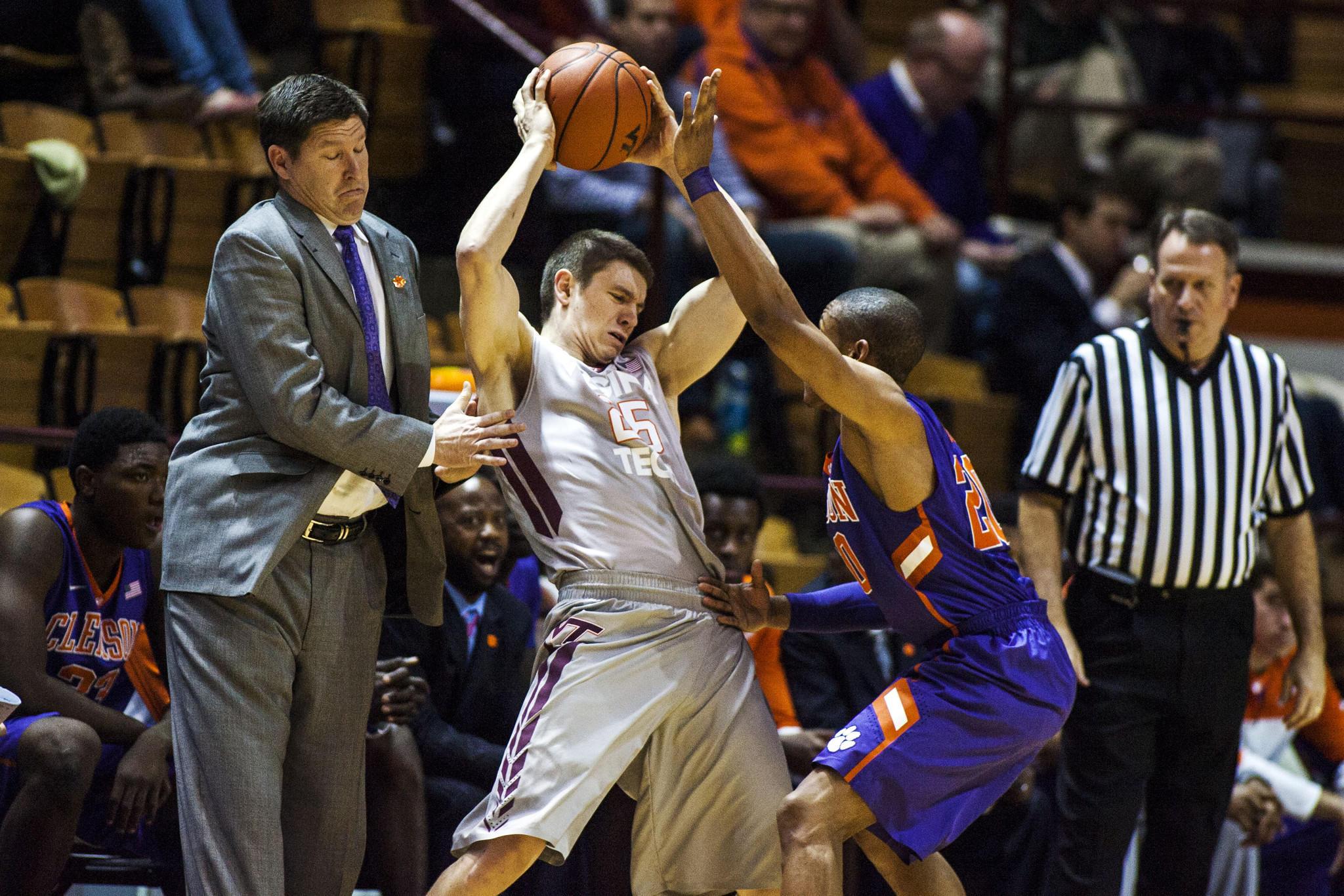 Clemson guard Jordan Roper fouls Virginia Tech guard Will Johnston as Clemson coach Brad Brownell reacts Wednesday in Blacksburg.
